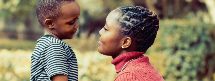 Woman and her child son looking into each other's eyes